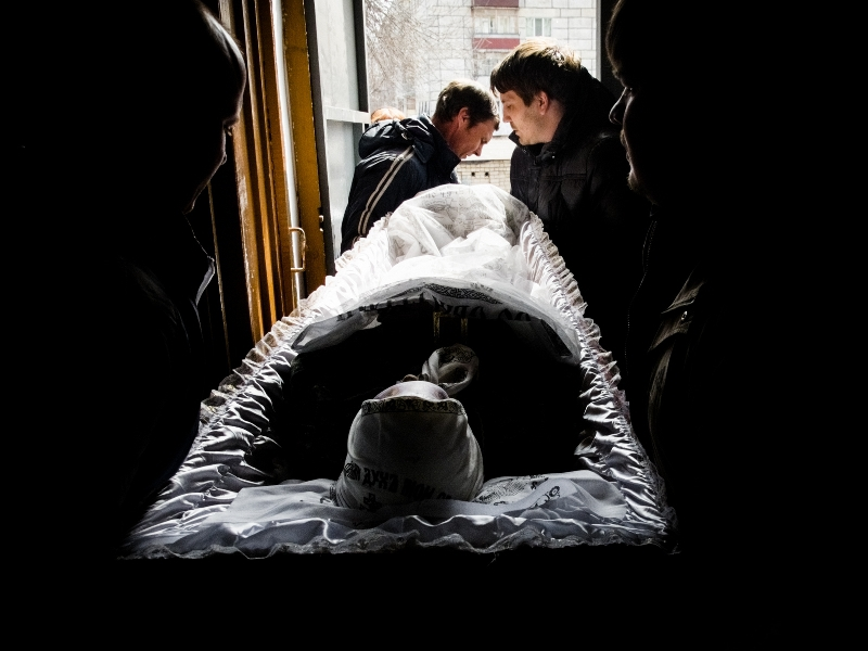 The woman is carried out in the coffin. Copyright Kristina Syrchikova, 2015.